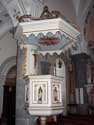 Saint-Nicholas RAEREN picture: The church contains a white pulpit that was decorated with gold.